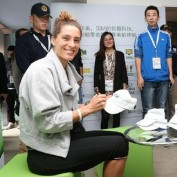 andrea-petkovic-signing-autographs-for-fans-beijing-china-open-happy-german-tennis-player-smiling